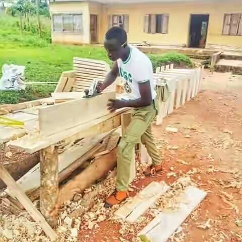 Photo of Nigerian Corps Member, Stephen Moses Teru, builds free learning facilities for 2 neglected public schools in Cross River State